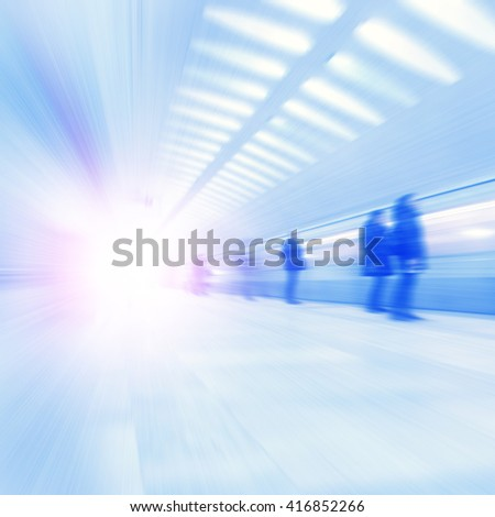 Train in motion blur and blurred people at subway station. - stock photo