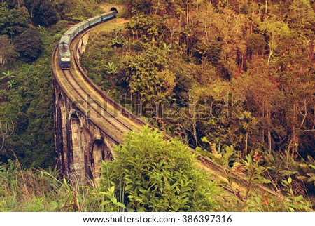 train in Rail road tunnel Demodara Nine Arch Bridge, Gotuwala, Ella, Sri Lanka - stock photo