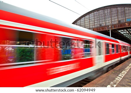 train leaves the station with speed - stock photo