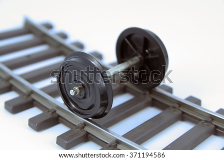 Train model wheels. Train wheels on a rail tracks.