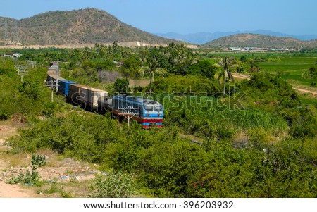 Train moving on rail to transport passenger and good cross Binh Thuan, Viet Nam, green landscape at Binhthuan, Vietnam rural on day rural on day