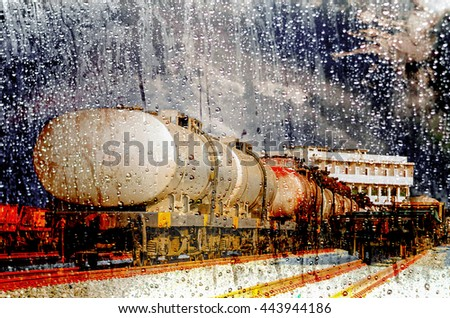 train of tanker cars transporting crude oil on the tracks.double exposure - stock photo