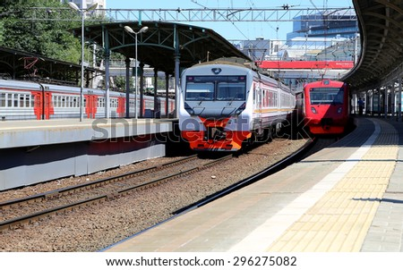 Train on Moscow passenger platform (Belorussky railway station) is one of the nine main railway stations in Moscow, Russia - stock photo