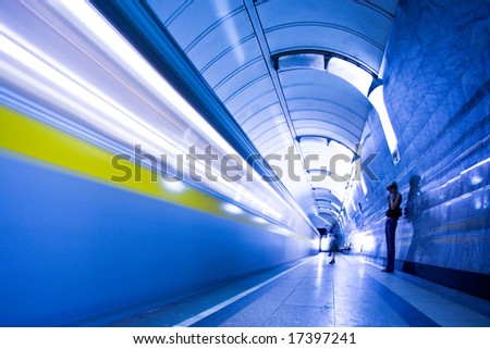 train on platform in subway and people crowd - stock photo