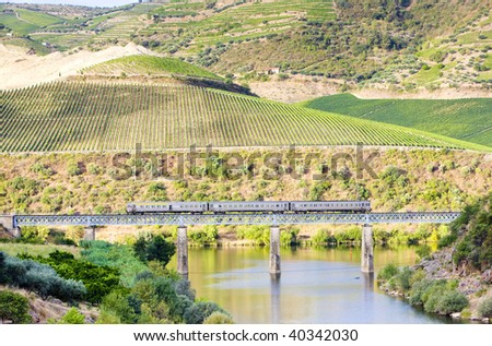train on railway viaduct in Douro Valley, Portugal - stock photo