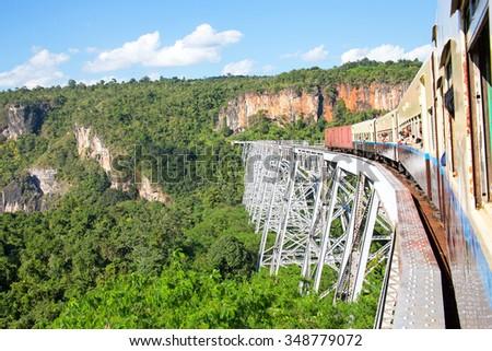 Train on the Goteik viaduct in Myanmar - stock photo