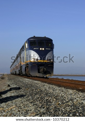 train on the tracks moving quickly - stock photo
