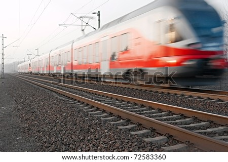 Train passing by with motion blur - stock photo