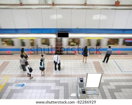 Train passing subway station - stock photo