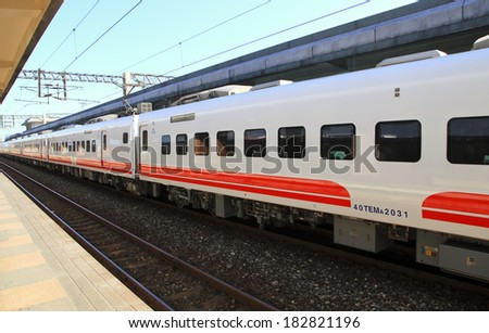 train passing train station  - stock photo
