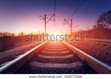 Train platform at sunset. Railroad in Ukraine. Railway landscape. - stock photo