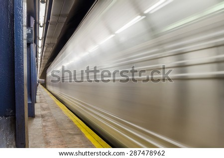 Train Pulling into the Platform of a Subway Station. Motion Blurred. - stock photo