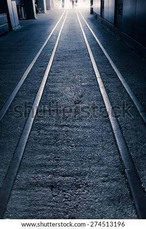Train rails leading toward light, High Line Park NYC - stock photo