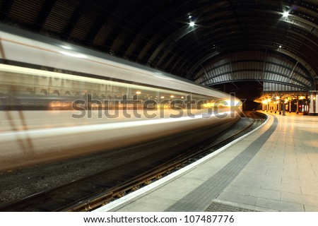 train speeding through York train station. - stock photo