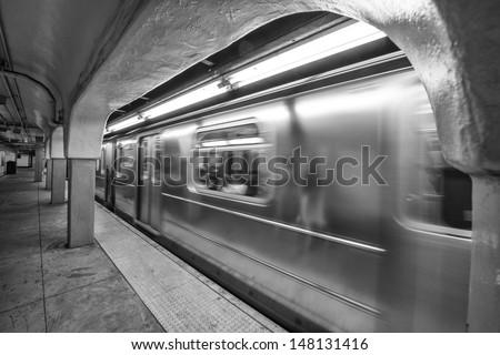 Train speeding up in New York City subway station. - stock photo