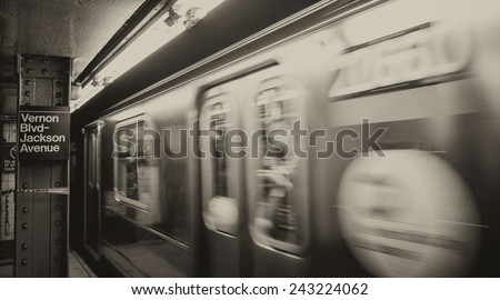 Train speeding up in the New York Subway. - stock photo