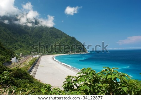 train station beside the ocean with blue sky an - stock photo