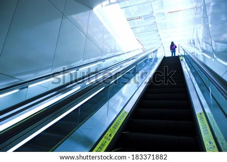 train station escalators in taiwan - stock photo