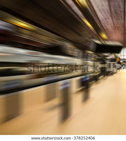 Train station in motion blur - Speed concept - stock photo