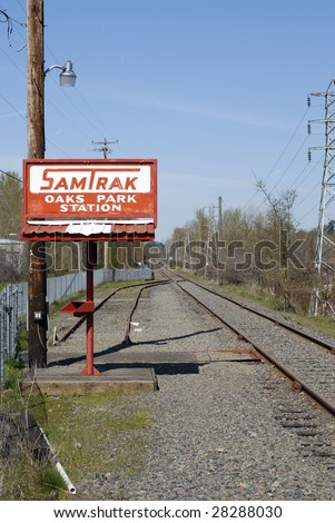 Train station outside Portland Oregon. With bike trail running along the railroad tracks. - stock photo