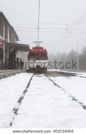 Train stopped to pick up passengers at the mountain station in Cotos, Madrid, Spain.