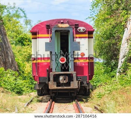 Train tours and train running  past tunnel  kanjanaburi,Thailand - stock photo