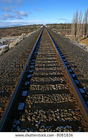 train track extending away into the distance - stock photo