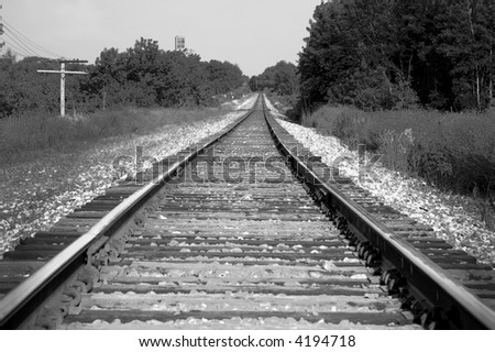 Train tracks fading towards the horizon in black and white