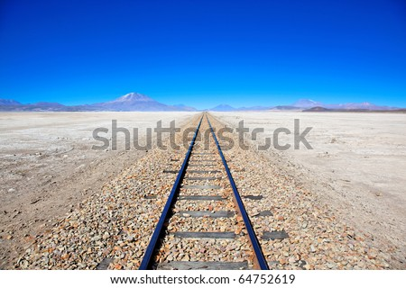 Train tracks in desert, Bolivia, South America - stock photo
