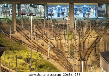 Train tracks in switch yard in Hong Kong at night - stock photo
