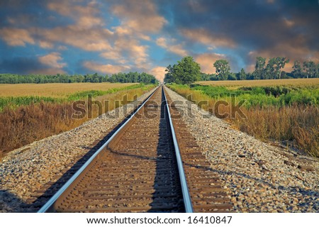 Train tracks running into the distance - stock photo