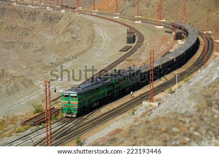 train transports ore from the mine - stock photo