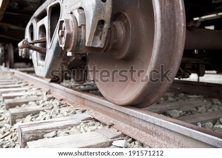 train wheel on the railroad track - stock photo