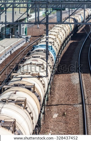 Train with tank carriages on the railway station. - stock photo