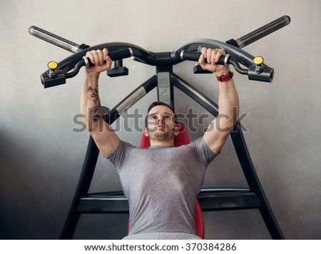 trainer handsome man in gym - stock photo