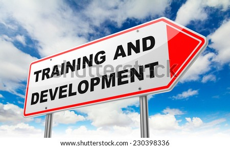 Training and Development - Inscription on Red Road Sign on Sky Background.