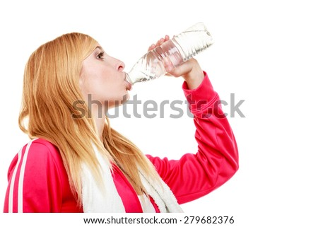 Training and workout. Fitness woman sport girl with white towel on shoulders drinking water from bottle isolated on white.