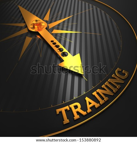 "Training - Business Background. Golden Compass Needle on a Black Field Pointing to the Word ""Training"". 3D Render. - stock photo"