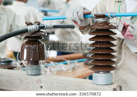 Training Engineer to crafting insulator, cable, wiring and workshop - stock photo