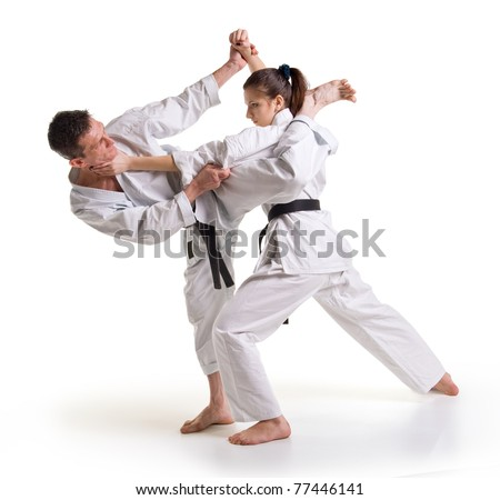 Training fight.two fighters on a white background.hand-to-hand fighting.man and woman.punch.karate