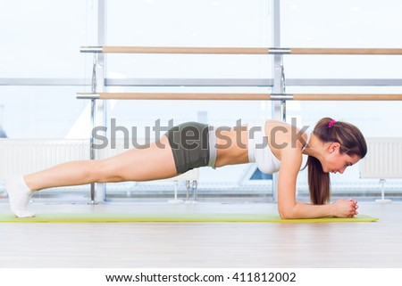 training fitness woman doing plank core exercise working out for back spine and posture Concept pilates sport - stock photo