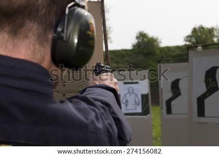 Training of police shooting at a shooting range - stock photo