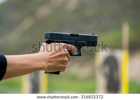 Training of soldiers firing pistol . Anti-Terrorism Unit - stock photo