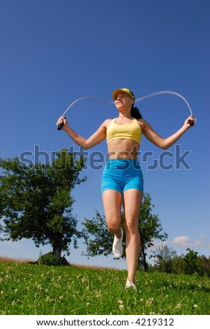 Training with a skipping rope on the nature - stock photo