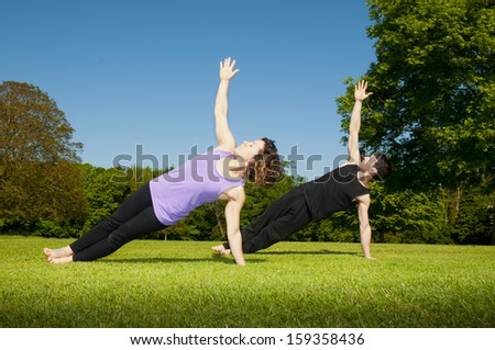 Training Yoga in a park - stock photo