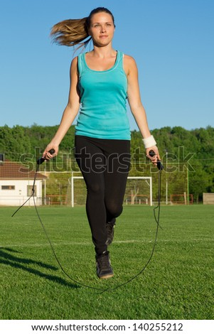 Training / Young woman training with a jumping rope - stock photo