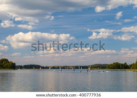 TRAKAI, LITHUANIA - 22 AUG 2015: Windsurfers training on the lake in sunny day