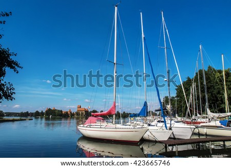 Trakai, Lithuania - August 6, 2013: Yacht on Lake Galve with Trakai castle in the background, Lithuania.