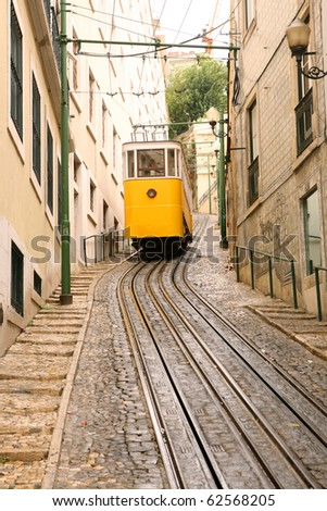 Tram Climbing Hill in Lisbon - stock photo