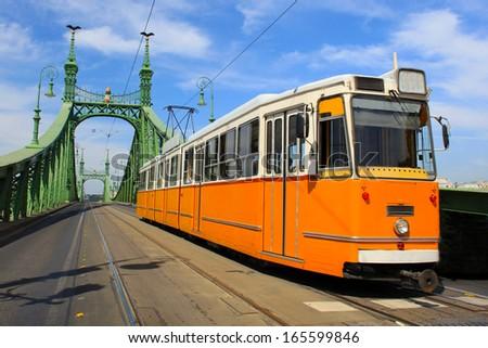 Tram coming from Freedom bridge, Budapest, Hungary  - stock photo